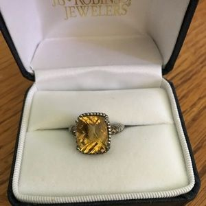 Lab created gold stone with sterling silver band.